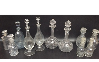 A pair of Victorian cut glass shaft-and-globe decanters with...