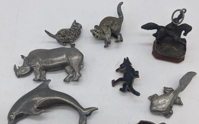 A seal mounted with horse and rider, and other animals