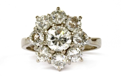 A white gold diamond cluster ring