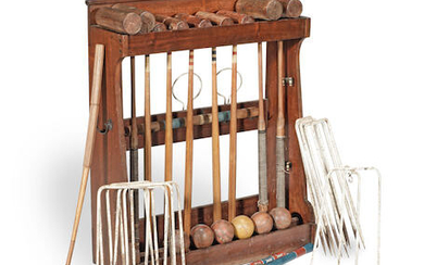 An early 20th Century composite Jacques part Croquet set on oak stained stand