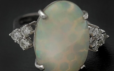 An opal and diamond ring set with a cabochon-cut opal weighing app. 6.53 ct. encircled by diamonds, mounted in 14k white gold. Size app. 53. – Bruun Rasmussen Auctioneers of Fine Art