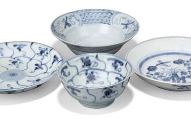 Four pieces of Chinese blue and white porcelain excavated from the Tek Sing cargo, 19th century, comprising two bowls, 12.5 and 17cm diameter, and two dishes, 18cm diameter (4)