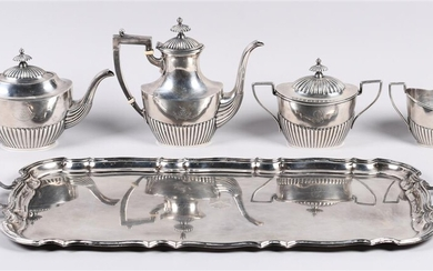 GORHAM SILVER CRESTED FOUR-PIECE TEA SET AND BARKER BROS. SILVER CRESTED RECTANGULAR TWO-HANDLED TRAY, BIRMINGHAM 1936