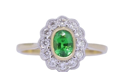 GREEN GARNET AND DIAMOND CLUSTER RING, set with a central gr...