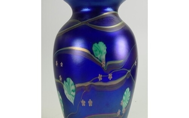 Okra art glass vase: Decorated with iridescent floral design...