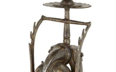 Property from an Important Private Collection A koftgari steel inkwell and candlestick, India, late 19th century, India, late 19th/early 20th century, of whimsical and unusual shape, resting on three curved legs, one foldable, the candlestick...