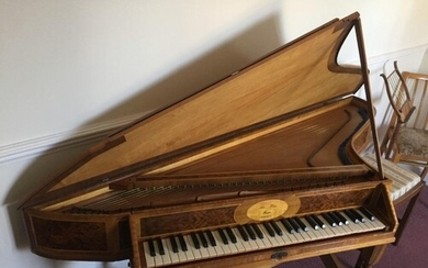 Spinet by Alan Whear A wing spinet in a walnut case with bur...