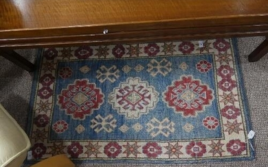 Tribal Rugs; two pale blue ground small rugs, each with styl...