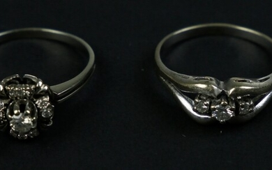18k white gold crossover ring set with diamonds, and a...