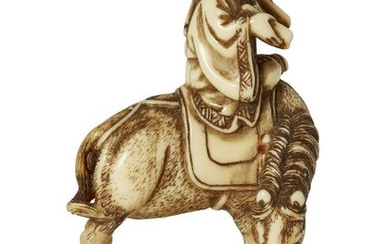 A Japanese ivory Netsuke by Minkoku, late 18th- early 19th century, carved intricately as a scholar atop a horse, the scholar holds an open scroll, horse stood on rocks at the water's edge, 5cm
