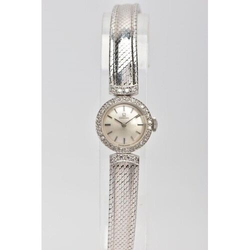 A LADY'S OMEGA 18CT GOLD AND DIAMOND WRISTWATCH, a round cas...