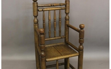 A REPRODUCTION TURNERS CHAIR. Of elaborate turned constructi...