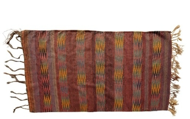 A TURKISH KILIM RUG with a striped red ground, the ends fini...