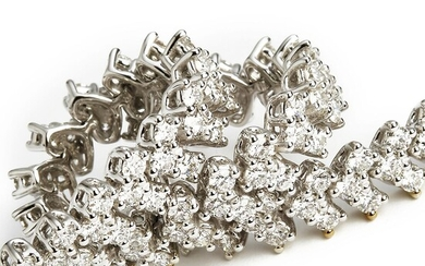 NOT SOLD. A diamond bracelet set with numerous brilliant-cut diamonds weighing a total of app. 5.64 ct., mounted in 18k white gold. F-G/VS. Triple ex.-cut. H & A. – Bruun Rasmussen Auctioneers of Fine Art