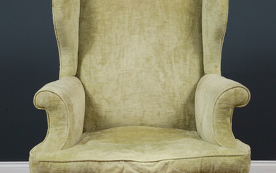 A late 19th century Georgian style green upholstered wingback armchair...