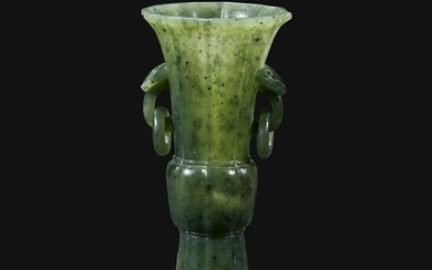 A small Chinese carved spinach green jade vase