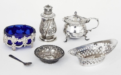 A small group of silver comprising: a Victorian silver pepper with hinged lid, London, c.1885, Rosenthal, Jacob & Co.; a silver mustard, Chester, c.1901, Jay, Richard Attenborough & Co; a blue glass salt in pierced silver mount, stamped 800; a...