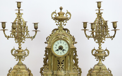 ADOLPHE MOUGIN. FRENCH CHIMNEY CLOCK WITH 2 FOUR-ARMED CANDLESTICK, BRASS. RICH ORNAMENT 19TH CENTURY.