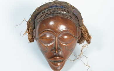 African dance mask carved in patinated wood, mounted...