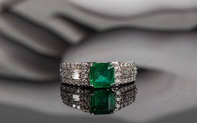 Emerald ring with diamonds.