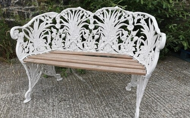 Good quality cast alloy two seater garden bench decorated wi...