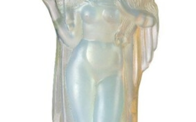 Sabino (French), an opalescent glass figure of a 'lady holding a lamb', c.1930, moulded Sabino Paris, engraved on the back of the base Sabino Paris, Moulded as a partially draped woman carrying a lamb across her shoulders, on integral base, 17.5 cm...
