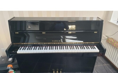 Yamaha (c2000) A Model C110A upright piano in a modern style...