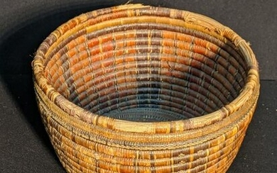 A 19th century tribal Oceanic food storage basket with