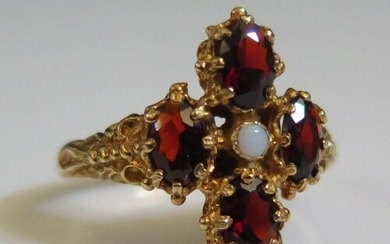 A 9ct Yellow Gold, Garnet and Opal Ring, size S, 4.6g