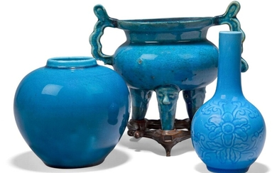 A Chinese porcelain monochrome turquoise glazed tripod censer, 18th century, of bombe form raised on three mask moulded legs, 13cm high, fitted hardwood stand, also two 20th century turquoise glazed vessels (3) Provenance: From the collection of an...