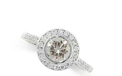 A DIAMOND ENGAGEMENT RING in platinum, set with a round