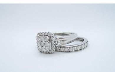 A Diamond Cluster Ring the square mount pave-set nine brilli...