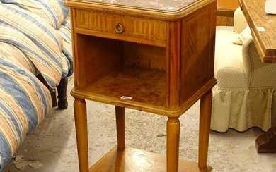 A French walnut and satinwood-banded marble-top bedside cabi...