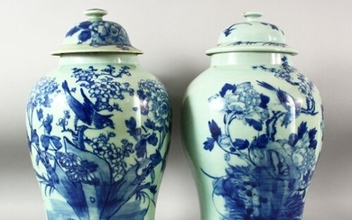 A LARGE PAIR OF CHINESE CELADON GLAZED POTTERY JARS AND COVE...