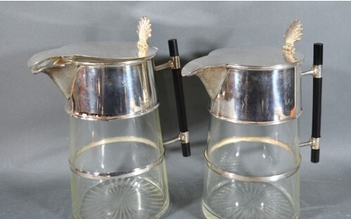 A Pair of Silver Plated and Cut Glass Claret Jugs in the sty...