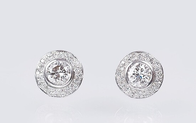 A Pair of Solitaire Diamond Earstuds with Diamonds.