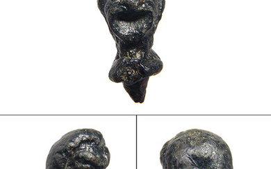 A Roman bronze head of an actor with nice detail
