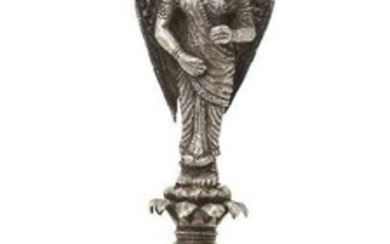 A large repousse decorated silver rosewater sprinkler, Lucknow, North India, 19th century, on raised foot, the drop-shaped body rising to a waisted and ringed neck and elongated stem worked in the form of an angel, the repoussé decoration depicting...