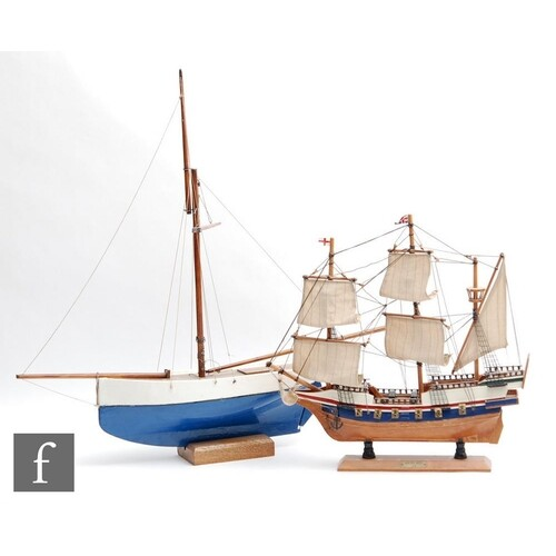 A mid 20th Century wooden pond yacht with painted blue and w...