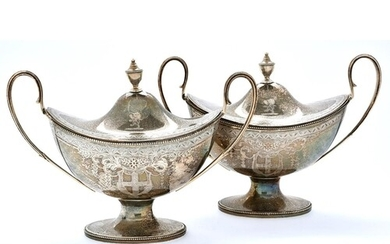 A pair of George III neo classical silver sauce tureens and ...