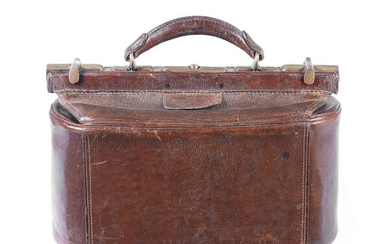 An early 20th century leather and brass cased bowls bag and contents
