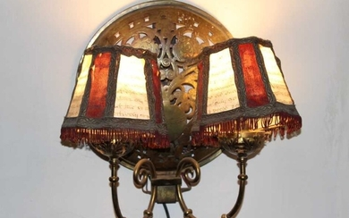 Pair of brass twin branch wall lights, each with domed panel, formed from warming pan covers