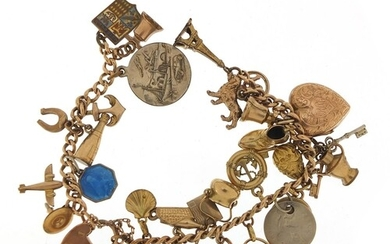 9ct gold charm bracelet with a selection of gold and metal c...