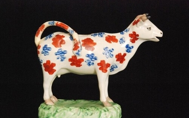 A 19th Century Welsh cow creamer, possibly Cambrian, with bu...