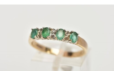 A 9CT GOLD EMERALD AND DIAMOND HALF ETERNITY RING, designed ...