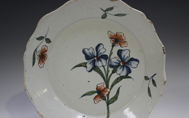 A Delft plate, 18th century, painted in blue, green and red with a floral spray, diameter 22.5cm (sm