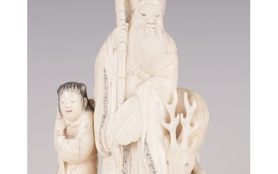 † A FINELY CARVED CHINESE IVORY SCULPTURE depicting a sage w...