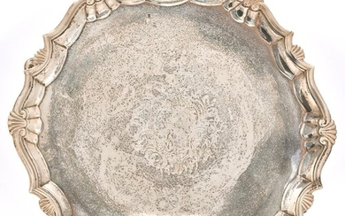 A George II silver salver, the moulded border with shells at...