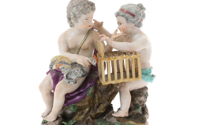 A MEISSEN FIGURE MODELLED AS TWO PUTTI SEATED WITH A ROOSTER AND CAGE, SECOND HALF 19TH CENTURY.