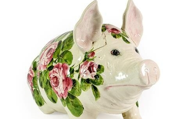 A Wemyss Pottery Pig, early 20th century, naturalistically modelled seated,...